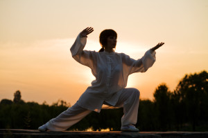 woman in white suit make's taiji chuan exercise - 5